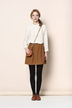 Des Petits Hauts  Brown skirt, white blouse (patterned blouse), black tights, brown shoes, brown bag