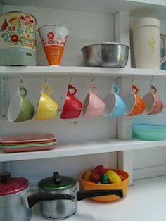 "accessories - I like the mix of toys, repurposed ""grown-up"" dishes, and vintage canisters"