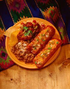 Top homemade enchiladas with taco sauce.