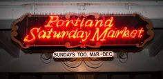 The neon sign under the Burnside Bridge for the Portland Saturday Market.