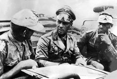 "German Field Marshal Erwin Rommel, renowned as ""the Desert Fox."" The German soldier holding the map was Rommel's executive assistant/personal interpreter, Wilfried ""Willy"" Ambruster."