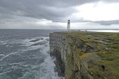 Brough Noup Head cliffs and lighthouse in Westray, Orkney, Scotland