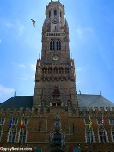 The bell tower of Bruges, Belgium - See more: http://www.gypsynester.com/tulips.htm @vikingriver