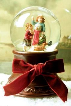 """Heirloom Snowglobe Snowman. Designed by Victorian Trading Co. for Demdaco, each crystal diorama tells a story. Inspired by our archival prints. Limited Edition. 7""""."""