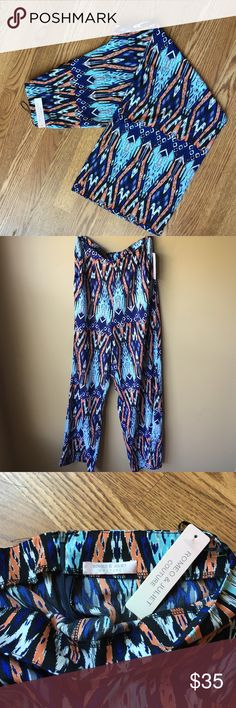 Romeo and Juliet palazzo pants Gorgeous! New with tags. This was a sample pair. Pockets and zip closure Romeo & Juliet Couture Pants Wide Leg