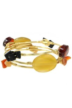 "Deep, Fall, Autumn hues combine in this stunning three gold wire wrapped bracelet trio. This three bangle set can be worn separately, or together, depending upon your style needs. One bangle has burnt orange and black stones; one has large pale yellow stones and one has orange chips. The bangles measure 2.5"" in diameter and are one size fits most. Since some of the stones are natural, please allow for slight variations in color and shape.   Semi-Precious Gem Bracelet by OORI. Accessories…"