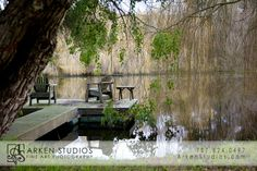 T shaped dock under trees