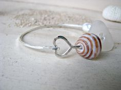 Beachy Bangle, Heart Bangle, Hawaii Seashell Bangle, Hawaii Pearl Bangle, Beach Glass Bangle, Sea Glass, Hawaii Puka Shell, Hammered Silver by PukoaPacificPearls on Etsy https://www.etsy.com/listing/200763047/beachy-bangle-heart-bangle-hawaii