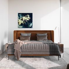 Designed by Henrik Pedersen, the new Austin bed's headboard is designed to have great upper and lower back support. Enjoy a good night's sleep with this warm and embracing Danish look.