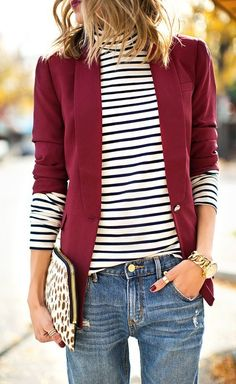 Shop this look on Lookastic: au.lookastic.com/... — White and Black Horizontal Striped Turtleneck — Red Blazer — White Leopard Suede Clutch — Gold Watch — Blue Boyfriend Jeans