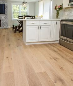 Oak Bluffs engineered hard wood floors are made from bright French Oak with rustic characteristics and periodic knots. Engineered Wood Floors, Kitchen Flooring, Engineered Timber Flooring, House Flooring, Wood Tile Bathroom Floor, Hardwood Floors, Reclaimed Wood Wall Decor, Home Kitchens, French Oak Flooring