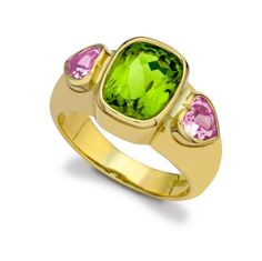 One of Kiki's latest exciting colour combinations is shown to great effect with this gorgeous ring from the Gypsy collection featuring a large central peridot with two heart shaped pink tourmaline gemstones, adding a subtle touch of romance to the 18ct gold yellow setting.