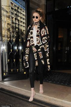 Walk this way: Supermodel Gigi Hadid is taking a break from the catwalk for a backseat role as she headed to Men's Fashion Week in Paris on January 20, 2016
