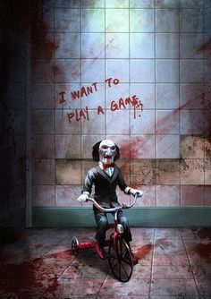 Jigsaw puppet. If he came cycling up to you, curiosity would get the better of ya. You,d have to pick him up, give it an ole' shake and be like, hay MR SAW, how does this work, go on show us, a go on, is there batteries in it, go on show us, a go on, a go on. I won't tell anyone! Where did ya buy it!