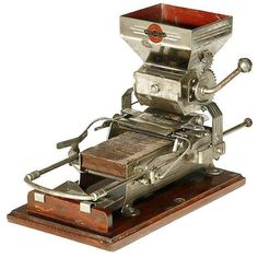 """""""Victoria"""" cigarette-rolling machine, c. 1920 I dont smoke but this is neat"""