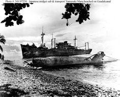Le transport japonais Yamazuki Maru échoué sur Guadalcanal avec un sous-marin de poche japonais. Cette bataille de Guadalcanal a été très couteuse pour les japonais. Alors qu'elle était encore en position de force en Août 1942, elle se retrouve sur la défensive après les pertes subies, surtout sur sa marine et son aéronavale, les Etats-Unis étant plus à même d'encaisser des pertes importantes et sur la durée