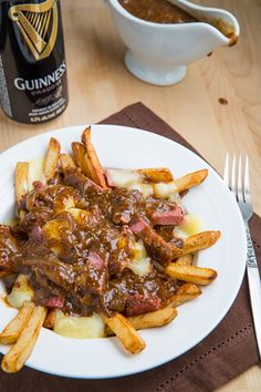 Guinness and Corned Beef Poutine - This sounds like the best way ever to use up corned beef leftovers!