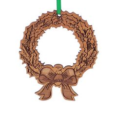 This flat Christmas Tree Ornament is laser cut from Alder, and it is engraved on one side. It depicts an Christmas Wreath and Bow. It is approximately inches wide by inches tall. Christmas Tree Bows, Xmas Tree, Ornament Wreath, Christmas Tree Ornaments, Laser Engraving, Engraving Ideas, Wine Supplies, Xmas Decorations, Laser Cutting