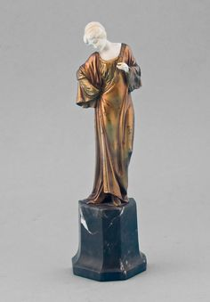 Art Deco ivory and gilt bronze statuette of lady on shaped marble base. - Gavin Douglas Antiques