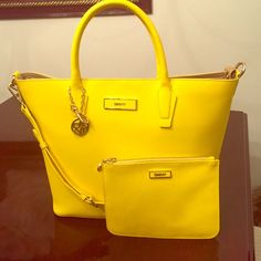 Yellow Dkny Handbag With Matching Pouch!!
