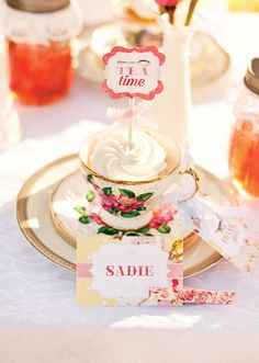 Adorable place setting for a little girl's Teacups & Tutu's Themed Birthday Party - I LOVE the mason jars with striped straws - looks dainty instead of rustic