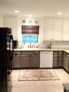 like the two tone cabinets. this could work well in our kitchen. from www.house185.wordpress.com