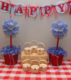 Dorothy's Birthday Banner, Blue Gingham Checked Topiary Trees, and Favor Baskets on a Hay Bale!