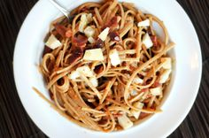 Whole Wheat Linguine with Tomatoes, Bacon and Manchego Cheese.  I would substitute bacon for Serrano ham