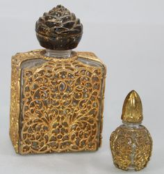 1940's Vintage Gold Filigree Perfume Bottles.. I had a bottle just like the large one it had a cross on it with Jesus I don't have it anymore, I just wonder if it was worth anything. Probably worth a lot, since I don't have anymore.