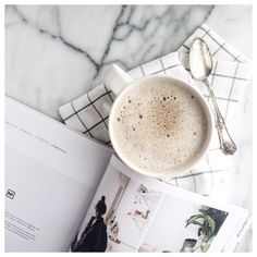 Coffee, cereal magazine, linens and marble. via @cassandramonroe https://www.instagram.com/p/BC2z4ibpyD-/