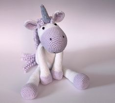 """Calista the Unicorn is a soft, floppy unicorn that measures around 48cm (19"""") measured from her toes to the tips of her horn when made using DK yarn with a 3.5mm crochet hook."""
