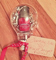 Super cute and easy holiday gift for the teachers in your life! Jamberry nail lacquer inside plastic light bulb ornament!  #Jamberry