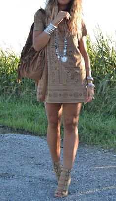 Love this all Gorge brown eyelet short sleeve dress with a short cut and matching tone shoes. That was so smart. Jewelry dead on and it all works for summer outfit.