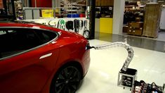 Charger prototype finding its way to Model S. Autonomous charging arm for the Tesla electric car.