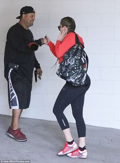 Buddy buddy: Khloe was seen bumping fists with someone on her way into the gym...
