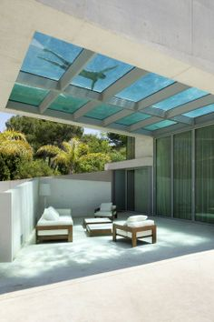 A home in Marbella, on the Mediterranean coast of Spain offers views of the sea while sunbathing or swimming in its rooftop glass-bottom pool.