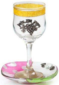 Glass Kiddush Cup with Bright Colored Motif and Saucer by World of Judaica. $34.00. Your order includes 1 item(s).. Material: Glass. Dimensions: 15. You will be pleasantly surprised! The vast majority of our shipments arrive within 10-14 business days from time of shipment, far in advance of Amazon's default calculation of shipping times for items shipped from Israel.. Liven up your Shabbat table as you say the kiddush blessing each week, with this bright and cheerful ...