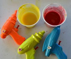 squirt gun painting. In the summer we are going to get a big canvas, wear old clothes, and go crazy with this.