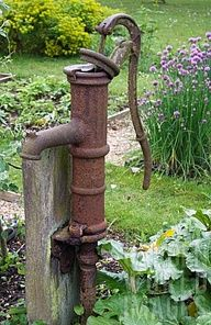 ANTIQUE WATERING PUMP.  I think this was in my yard growing up!