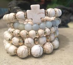Add a touch of style and design to any outfit with this unique stack of beaded bracelet designed and handmade in the South featuring semi-precious stone and gold accents. Each stack is carefully put together with perfect color combinations to accent the stones best features. Pair it