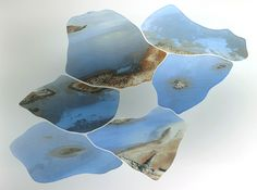 Our Directory Maker of the Week is Susan Kinley. Island Fields combines water jet cut glass with fired fragments of aerial photographs of the Isles of Scilly. Shapes are drawn from ancient field systems in West Penwith, Cornwall. #glass #crafts #craftscouncil #ccdirectory www.craftscouncil.org.uk/directory