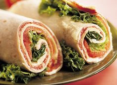 Fiesta Tuna Wrap with Swiss Cheese. Combine one can of drained tuna with 1/4 cup of chopped red bell pepper and 1/4 cup of chopped green bell pepper. Add mashed avocado. Divide mixture between two tortillas and spread evenly. Line each tortilla with 4 cheese slices, and lettuce and tomatoes. Roll up and slice. Enjoy!