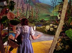 Dorothy emerges from her fallen house into Munchkinland