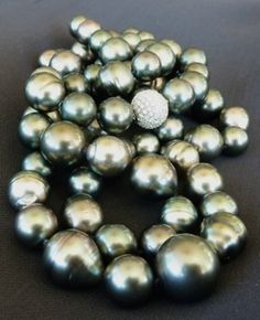 Luminous black south sea pearls reflecting the sea's very beginnings in each orb.