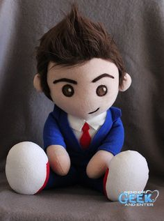 Tenth Doctor! Want! I'd buy that doll just so I could ruffle its hair and pretend it's actually David Tennant.