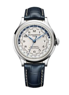 For the globetrotting groom, the elegant 44 mm #Capeland 10106 #Worldtimer features 24 time zones based on the wearer's current location, and is delivered on a striking blue alligator strap.  He will always know what time it is at home when travelling with the Capeland Worldtimer. #baumeetmercier
