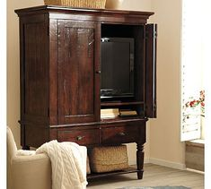 Pretty TV armoire from Pottery Barn. I like the aged look of the wood and the classic turned legs. Nice size, too. Not too big, but not too small. Would work in Bedrooms and Family Rooms alike.