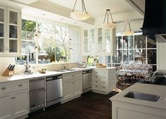 Los Angeles, California | Ferguson & Shamamian --while this kitchen is a bit cold in terms of layout and design, I like the huge, let-in-the-sunshine window. Make it more country/shabby chic, add a nice big natural wood kitchen table....