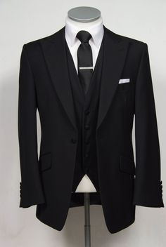 "grooms wedding suit in black slim fit light weight wool with classic waistcoat. Mens sizes from 32"" chest upward and include extra short, short, regular, long and extra long fittings. Boys sizes from 20"" to 34"" chest. Complete outfit includes jacket, skinny trousers, hire or matching waistcoat, brand new traditional or French wing slim fit shirt in white or ivory, tie or cravat, braces and cufflinks. £150.00 to hire #groom #wedding #suit #hire #suithire #scoop #waistcoat #black"