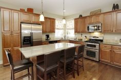 fridge cabinet Traditional Kitchen with Pendant Light, Simple granite counters, Pental Quartz Sparking White, Stone Tile, Raised panel